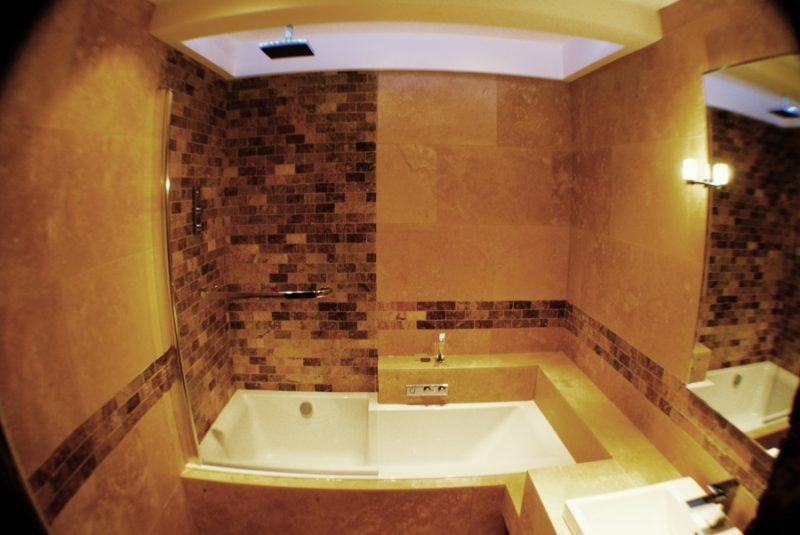 Contemporary bathroom with travertine tiles for Travertine tile bathroom gallery