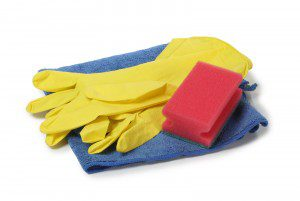 Protective rubber gloves and cleaning products on white backgroud