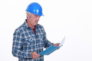 Engineer reading a report