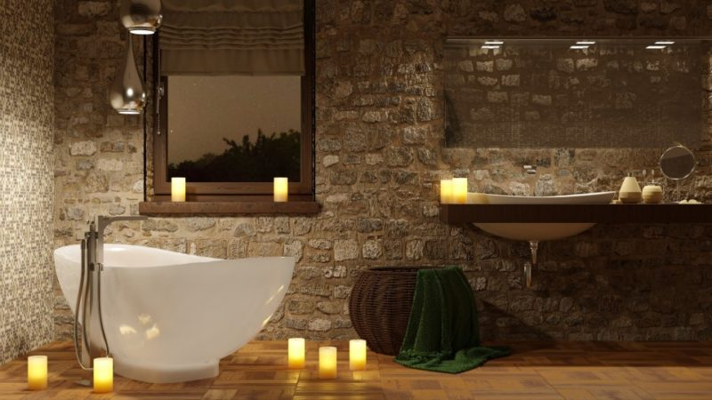 spa like bathroom with soaking tub and candles